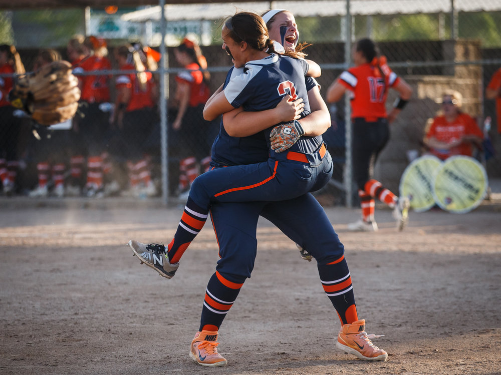 Rochester's Nicole Robinson (2) leaps into the arms of Rochester's Katie Nika (30) after the Rockets defeated Herrin 10-4 in the Class 3A Mattoon Supersectional at the Roundhouse Sports Complex, Monday, June 5, 2017, in Mattoon, Ill. [Justin L. Fowler/The State Journal-Register]
