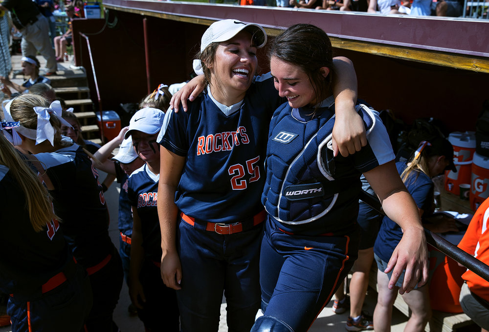 Rochester's Abby Blatz, left, and Rochester's Faith Day laugh together as they prepare to take the field against East Peoria during the Class 3A state semifinal game at the Eastside Centre Friday, June 9, 2017. [Ted Schurter/The State Journal-Register]