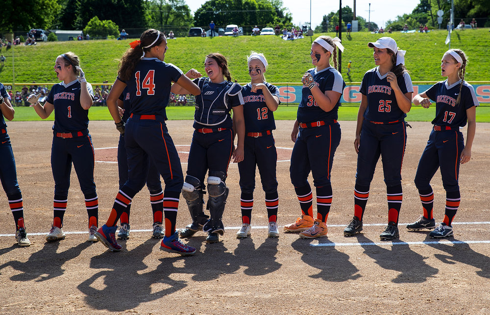 The Rochester Rockets greet Lyric Boone on the field during introductions before the Class 3A state semifinal game at the Eastside Centre Friday, June 9, 2017. [Ted Schurter/The State Journal-Register]