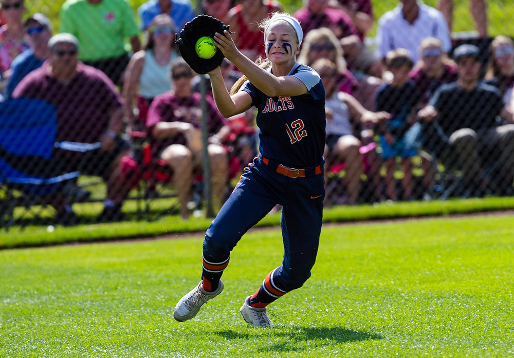 Rochester's Jillian Anderson fields a fly ball against East Peoria during the Class 3A state semifinal game at the Eastside Centre Friday, June 9, 2017. [Ted Schurter/The State Journal-Register]