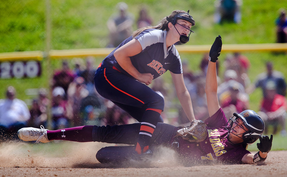 Rochester's Reagan Miles tags out East Peoria's Monique Hoosen at third base during the Class 3A state semifinal game at the Eastside Centre Friday, June 9, 2017. [Ted Schurter/The State Journal-Register]