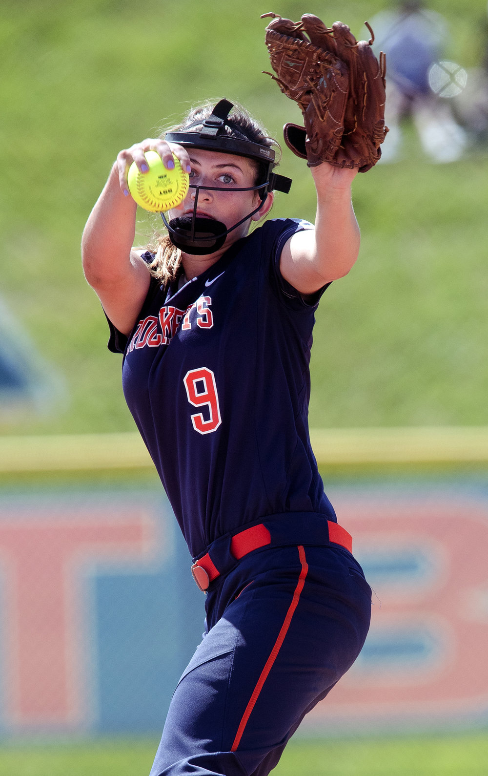 Rochester's Reagan Miles winds up against East Peoria during the Class 3A state semifinal game at the Eastside Centre Friday, June 9, 2017. [Ted Schurter/The State Journal-Register]