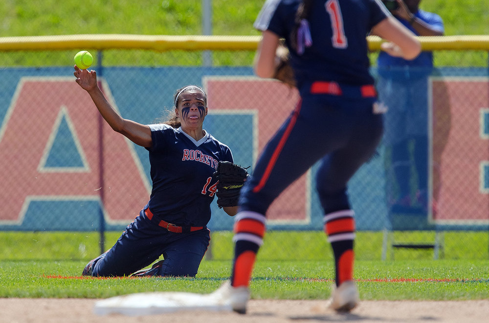 Rochester's Lyric Boone throws to second base after fielding a grounder against East Peoria during the Class 3A state semifinal game at the Eastside Centre Friday, June 9, 2017. [Ted Schurter/The State Journal-Register]
