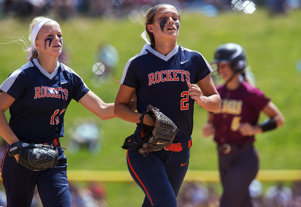 Rochester's Jillian Anderson pats Nicole Robinson on the back after she caught a two-out, bases loaded fly ball at the third base fence in the sixth inning against East Peoria during the Class 3A state semifinal game at the Eastside Centre Friday, June 9, 2017. [Ted Schurter/The State Journal-Register]