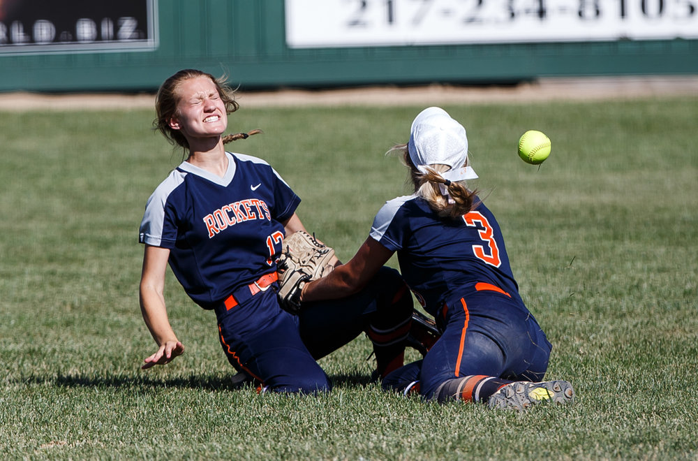 Rochester's Jadyn Zaffiri (17) and Rochester's Ali Bortmess (3) collide as they both go for a fly ball in the first inning during the Class 3A Mattoon Supersectional at the Roundhouse Sports Complex, Monday, June 5, 2017, in Mattoon, Ill. [Justin L. Fowler/The State Journal-Register]