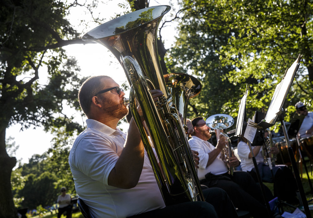 Pat Moore peforms on the tuba with the Springfield Municipal Band at the Thomas Rees Memorial Carillon during the 56th International Carillon Festival in Washington Park, Friday, June 9, 2017, in Springfield, Ill. [Justin L. Fowler/The State Journal-Register]