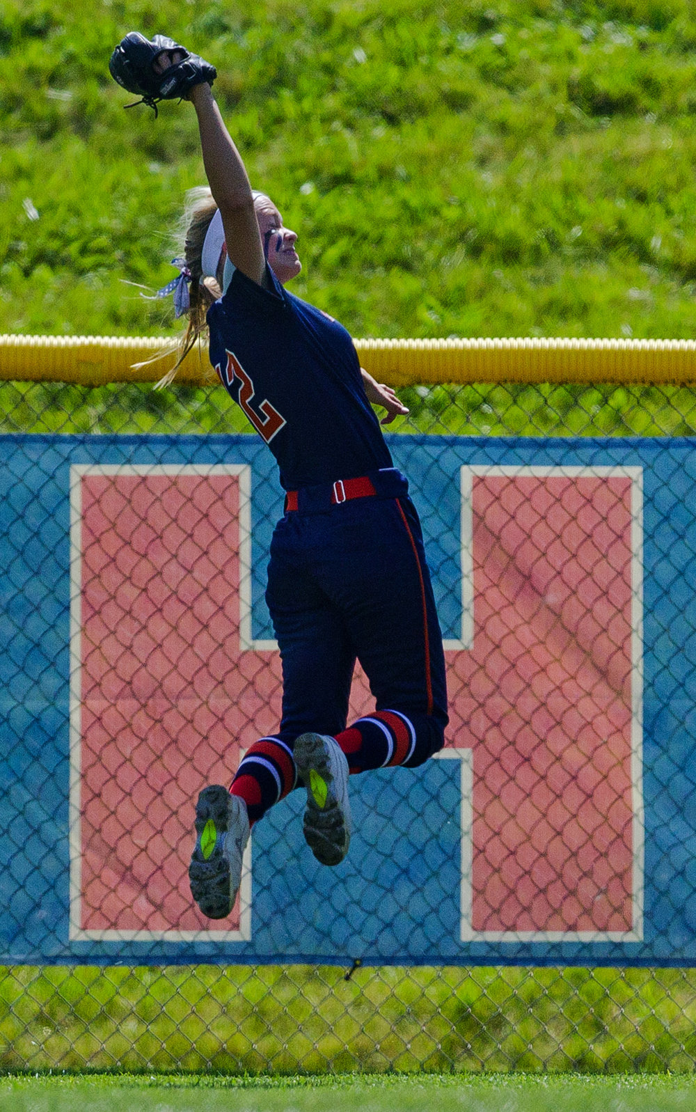 Rochester's Jillian Anderson makes a leaping catch near the fence against East Peoria during the Class 3A state semifinal game at the Eastside Centre Friday, June 9, 2017. [Ted Schurter/The State Journal-Register]