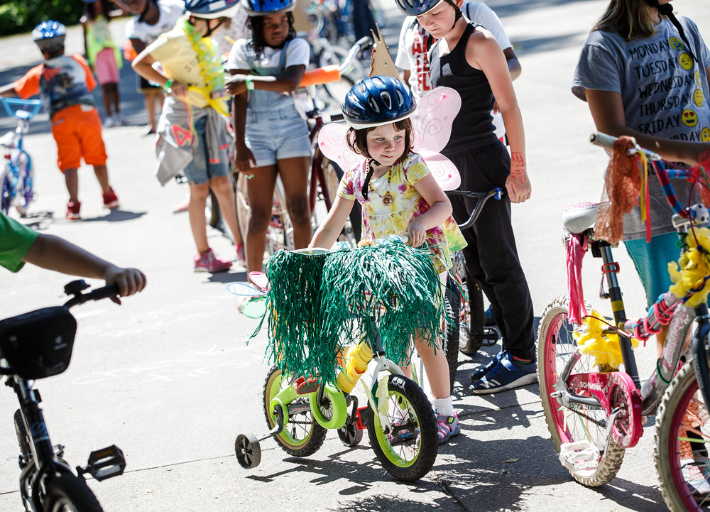 Evelyn Havey, 4, gets her decorated bike in line for the parade for the Enos Park Wacky Wheelers Parade hosted by Our Vibrant Community in Enos Park, Saturday, June 10, 2017, in Springfield, Ill. [Justin L. Fowler/The State Journal-Register]