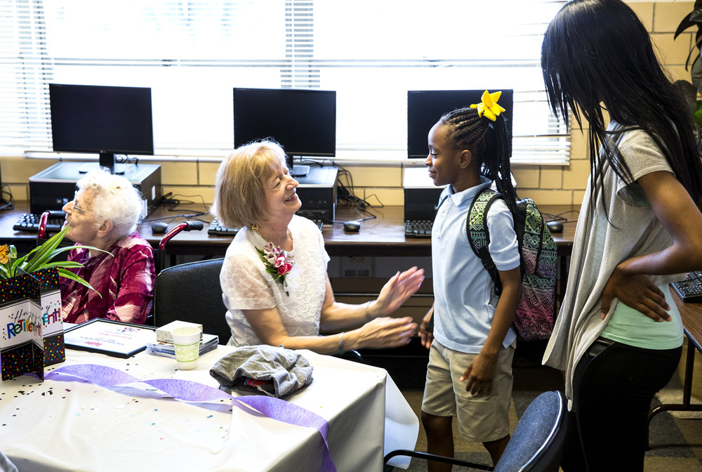"It was a celebration Monday, June 5, 2017 for Rose Marie Bates, retiring after 44 years of teaching at St.Patrick's School. But it also was a reunion with former colleagues and students, including Takiyah McCrary, one of her students two years ago. Bates began teaching at the school in 1973 when the enrollment was 300. ""I taught third grade when I started and I've taught every subject including art, P.E. and music. In music class back then we put a record on the record player and just sang along with it,"" Bates said. Sr. Kathlyn Mulcahy, who taught 8th grade at St.Pat's during the early 1990s, called Bates a master teacher. ""Her love for the kids was outstanding."" [Rich Saal/The State Journal-Register]"