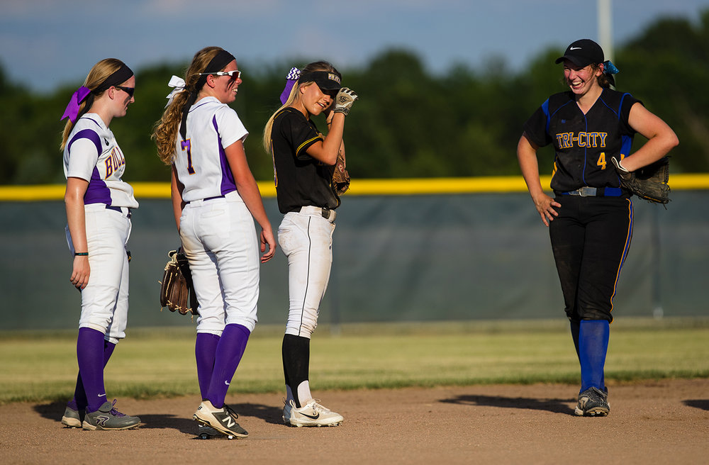 Tri-City's Aubrey Hunt laughs with other members of the Area All-Stars in between innings during the 2017 Land of Lincoln Softball Classic Monday, June 12, 2017. [Ted Schurter/The State Journal-Register]