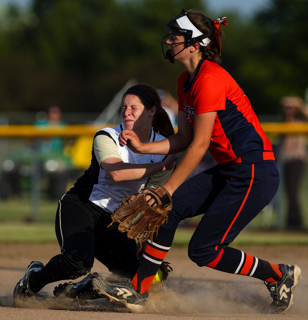 Sacred Heart-Griffin's Erin Schweska and Rochester's Reagan Miles narrowly avoid colliding as Schweska fields an infield grounder during the 2017 Land of Lincoln Softball Classic Monday, June 12, 2017. [Ted Schurter/The State Journal-Register]