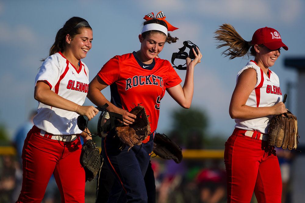 Rochester's Reagan Miles laughs as she comes off the field during the 2017 Land of Lincoln Softball Classic Monday, June 12, 2017. [Ted Schurter/The State Journal-Register]