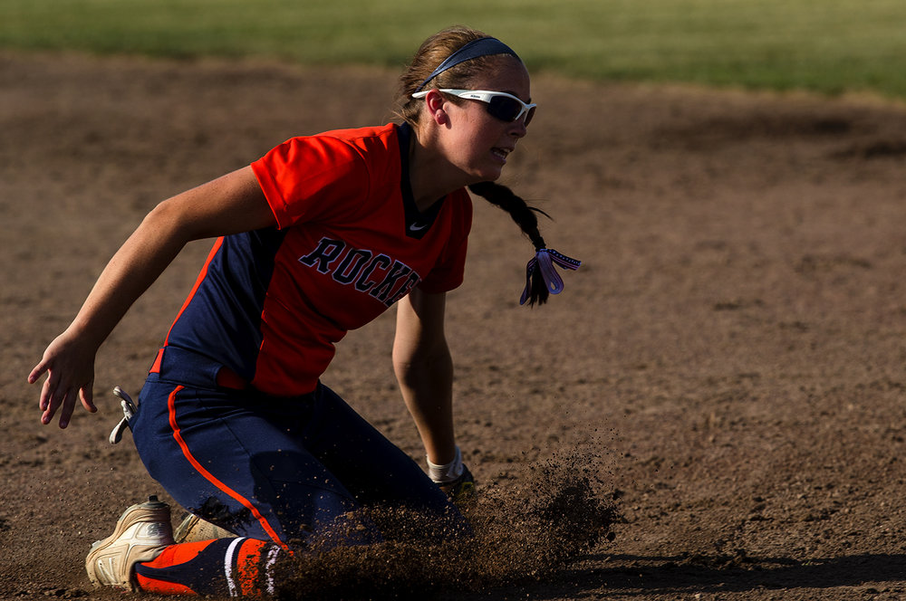 Rochester's Aubrey Magro slides on the infield as she makes a catch during the 2017 Land of Lincoln Softball Classic Monday, June 12, 2017. [Ted Schurter/The State Journal-Register]