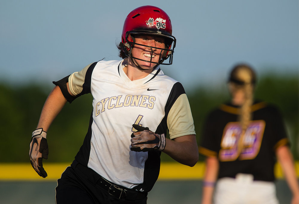 Sacred Heart-Griffin's Renee Abernathy smiles as she rounds the base after hitting a home run to tie the first game of the 2017 Land of Lincoln Softball Classic Monday, June 12, 2017. [Ted Schurter/The State Journal-Register]