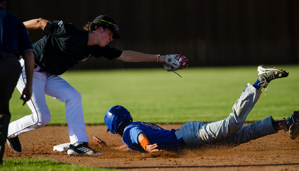 Springfield's Trevor Minder makes the tag on Riverton's Beau Atkins during the Baseball Classic at Claude Kracik Field Tuesday, June 13, 2017.  [Ted Schurter/The State Journal-Register]