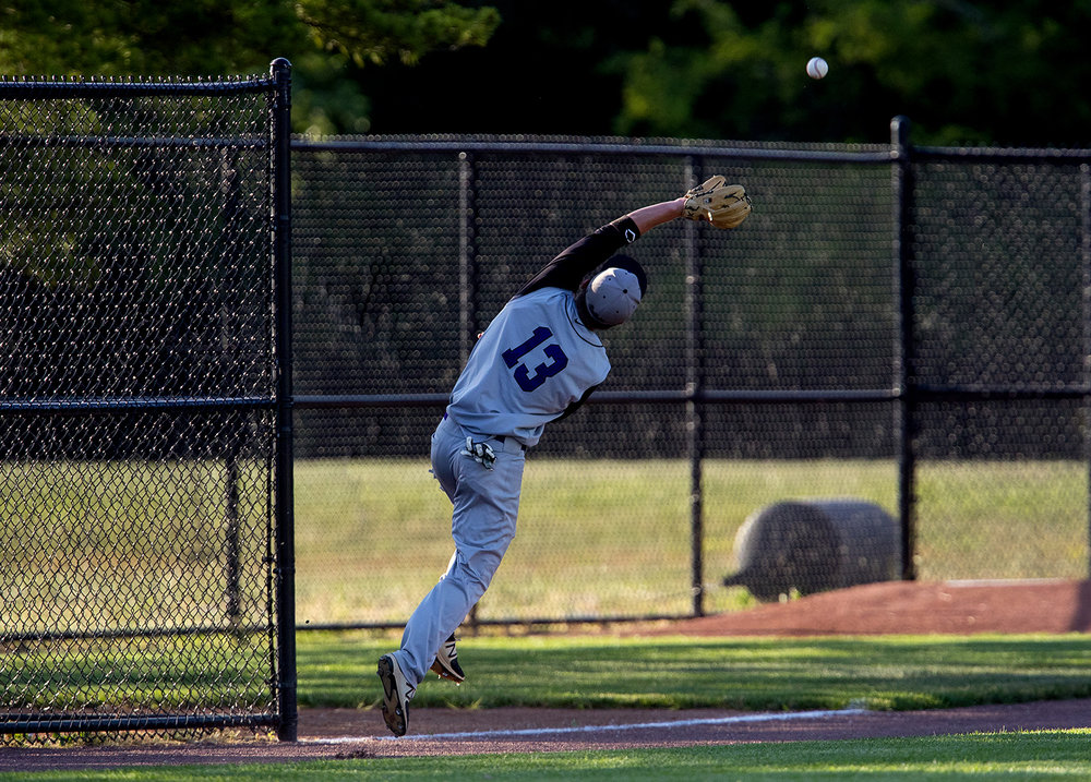 Williamsville's Talon File leaps for a fly ball during the Baseball Classic at Claude Kracik Field Tuesday, June 13, 2017.  [Ted Schurter/The State Journal-Register]