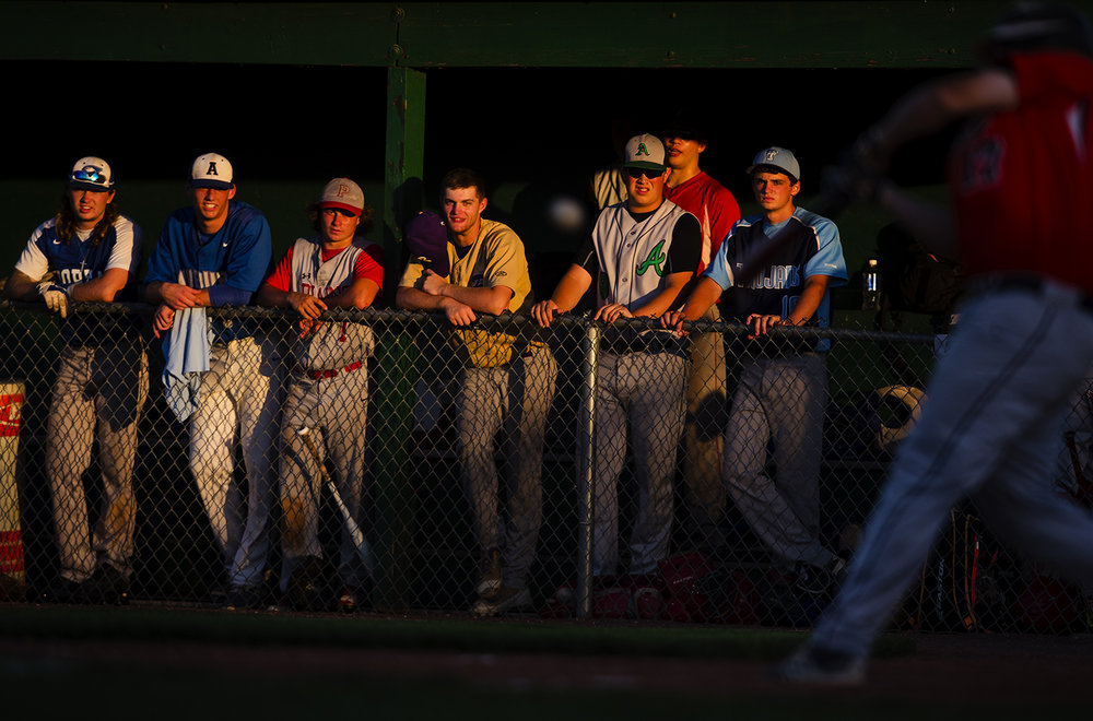 The All-Area Team watches from the dugout as Rout's Drew Winters makes contact during the Baseball Classic at Claude Kracik Field Tuesday, June 13, 2017.  [Ted Schurter/The State Journal-Register]
