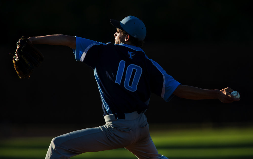 Triopia's Isaac Werries winds up during the Baseball Classic at Claude Kracik Field Tuesday, June 13, 2017.  [Ted Schurter/The State Journal-Register]