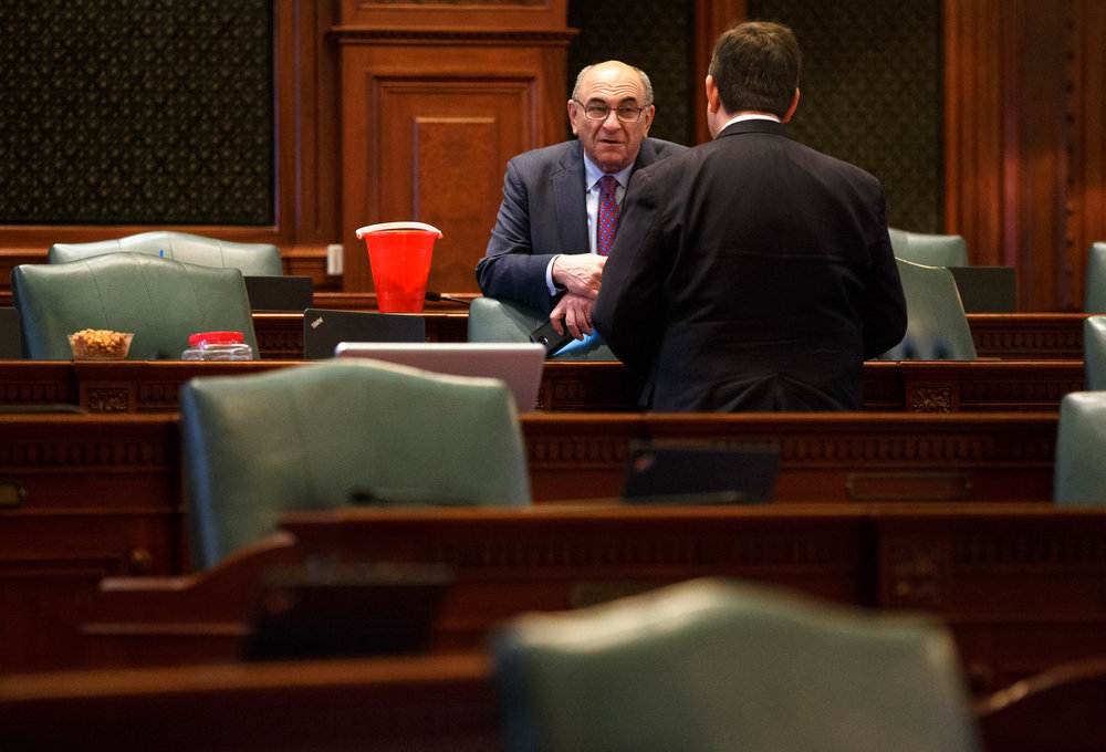 Illinois House Deputy Majority Leader Lou Lang, D-Skokie, talks with Illinois State Rep. David McSweeney, R-Barrington Hills, and the snack area as Republicans break for a caucus prior to debate on Senate Bill 9, a tax hike bill, during the overtime session at the Illinois State Capitol, Sunday, July 2, 2017, in Springfield, Ill. [Justin L. Fowler/The State Journal-Register]