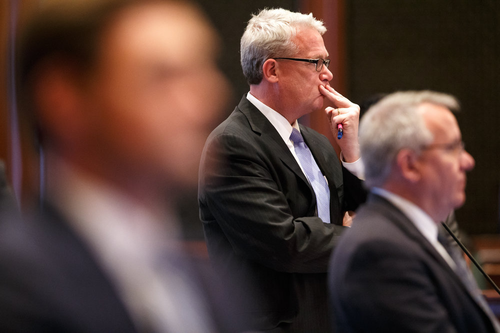 Illinois House Minority Leader Jim Durkin, R-Western Springs, listens as Illinois State Rep. Greg Harris, D-Chicago, answers questions during debate on the floor of the Illinois House on Senate Bill 9, a tax hike bill, during the overtime session at the Illinois State Capitol, Sunday, July 2, 2017, in Springfield, Ill. [Justin L. Fowler/The State Journal-Register]