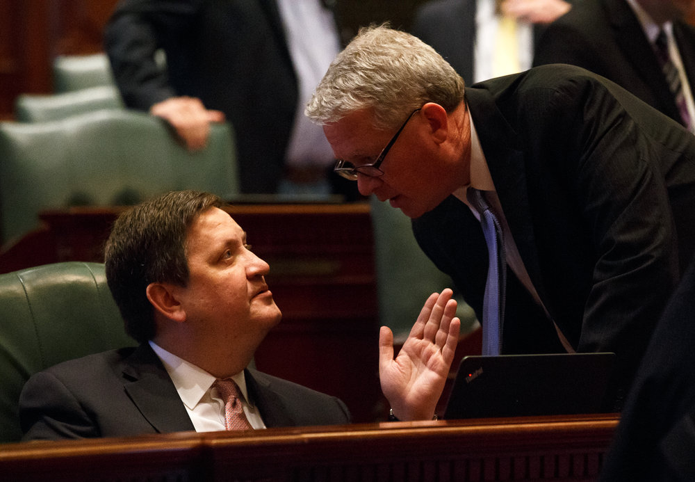 Illinois State Rep. David McSweeney, R-Barrington Hills, talks with Illinois House Minority Leader Jim Durkin, R-Western Springs, on the floor of the Illinois House prior to debate on Senate Bill 9, a tax hike bill, during the overtime session at the Illinois State Capitol, Sunday, July 2, 2017, in Springfield, Ill. [Justin L. Fowler/The State Journal-Register]