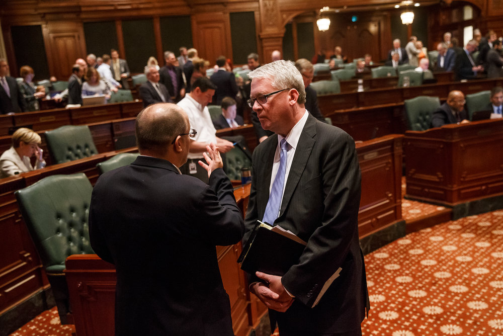 Illinois House Minority Leader Jim Durkin, R-Western Springs, talks with Illinois State Rep. Mark Batinick, R-Plainfield, on the floor of the Illinois House after Senate Bill 9, a tax hike bill, and Senate Bill 6, the spending plan, passed during the overtime session at the Illinois State Capitol, Sunday, July 2, 2017, in Springfield, Ill. [Justin L. Fowler/The State Journal-Register]