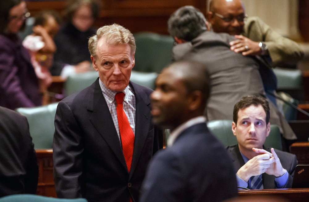 Illinois Speaker of the House Michael Madigan, D-Chicago, makes his way down the aisle of the floor of the Illinois House after Senate Bill 9, a tax hike bill, and Senate Bill 6, the spending plan, passed during the overtime session at the Illinois State Capitol, Sunday, July 2, 2017, in Springfield, Ill. [Justin L. Fowler/The State Journal-Register]