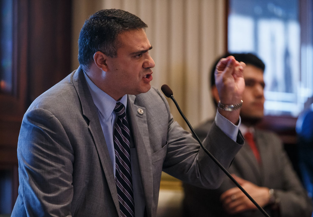 "Illinois State Rep. Mike Unes, R-East Peoria, delivers his remarks that he plans to vote for Senate Bill 9, a tax hike bill, on the floor of the Illinois House during the overtime session at the Illinois State Capitol, Sunday, July 2, 2017, in Springfield, Ill. ""For me today, right here right now, this is the sword I'm willing to die on and if it costs me my seat so be it,"" said Unes. [Justin L. Fowler/The State Journal-Register]"