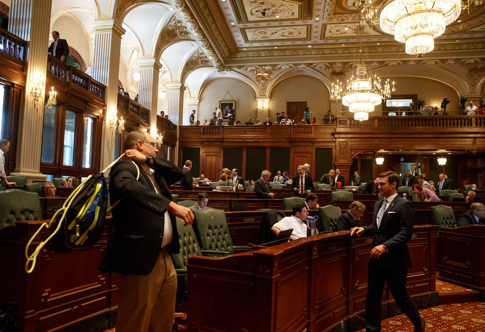 Illinois State Rep. Mark Batinick, R-Plainfield, throws his backpack over his shoulder as the Republicans leave for a caucus after the Democrats filed amendments to the spending and tax hike bills during the overtime session at the Illinois State Capitol, Sunday, July 2, 2017, in Springfield, Ill. [Justin L. Fowler/The State Journal-Register]