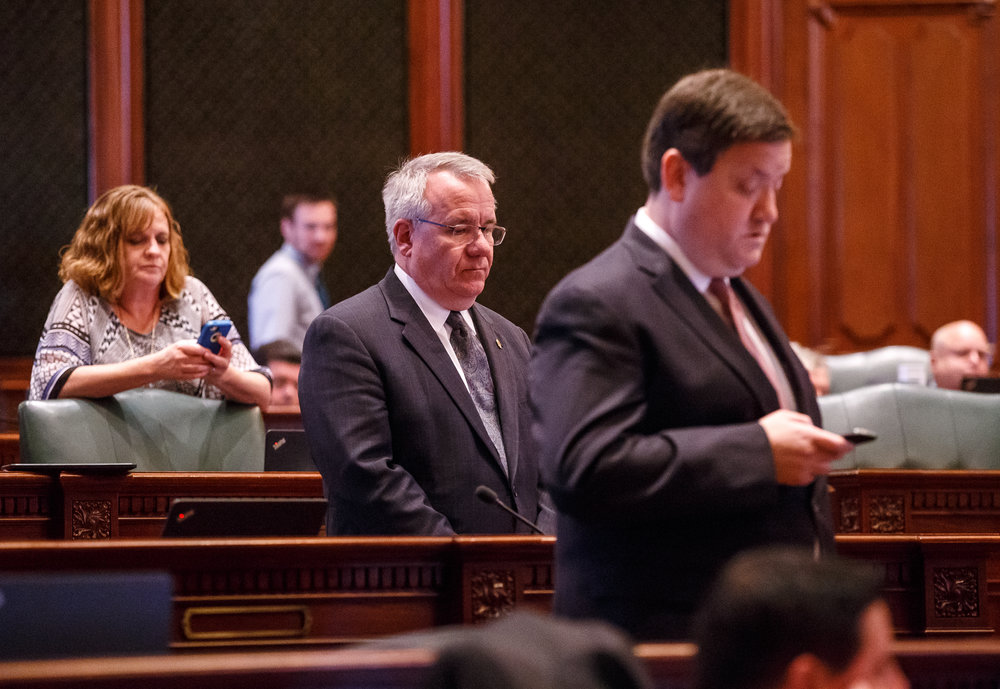 Illinois State Rep. Steve Andersson, R-Geneva, center, and his fellow legislatures stand at ease on the Illinois House Floor as they wait for a vote on a tax hike bill during the overtime session at the Illinois State Capitol, Sunday, July 2, 2017, in Springfield, Ill. [Justin L. Fowler/The State Journal-Register]