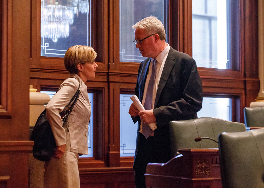Illinois House Minority Leader Jim Durkin, R-Western Springs, right, talks with Illinois State Rep. Sara Wojcicki Jimenez,R-Leland Grove, left, on the floor of the Illinois House as they prepare for a vote on a tax hike bill during the overtime session at the Illinois State Capitol, Sunday, July 2, 2017, in Springfield, Ill. [Justin L. Fowler/The State Journal-Register]