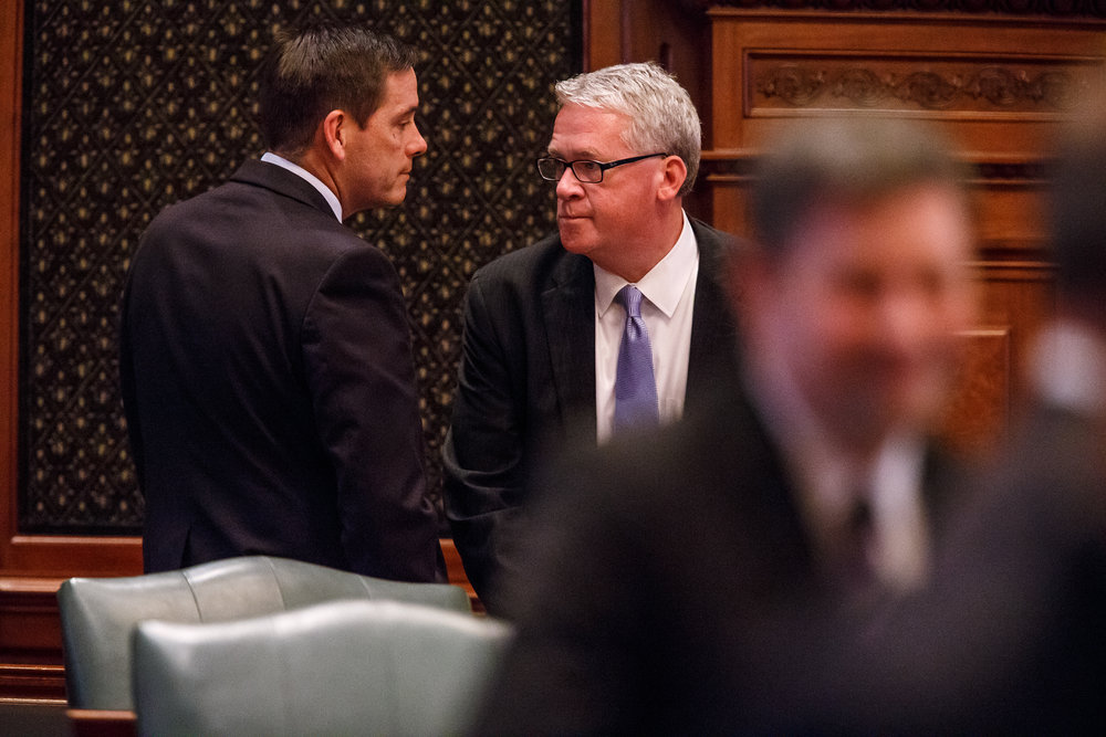 Illinois House Minority Leader Jim Durkin, R-Western Springs, right, talks with Illinois State Rep. Tim Butler, R-Springfield, left, on the floor of the Illinois House as they get ready to vote on a tax hike bill during the overtime session at the Illinois State Capitol, Sunday, July 2, 2017, in Springfield, Ill. [Justin L. Fowler/The State Journal-Register]