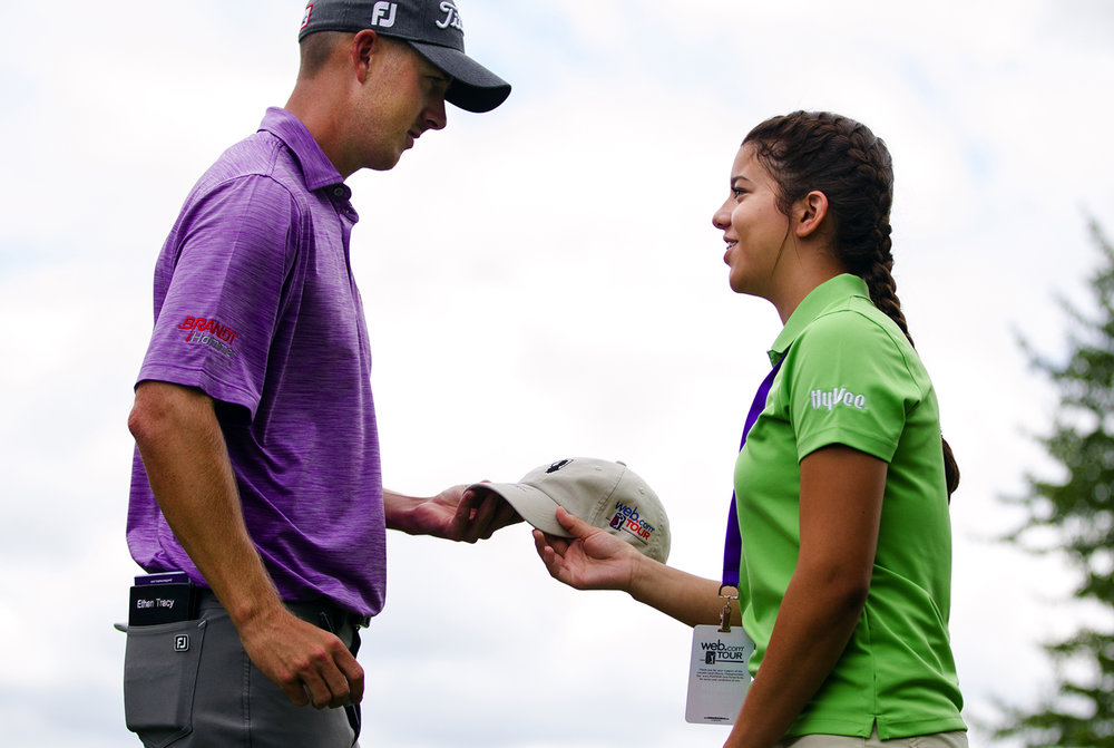 Ethan Tracy hands a hat back to Annie Harms during the first round of the Lincoln Land Charity Championship at Panther Creek Thursday, June 22, 2017. Ted Schurter/The State Journal-Register