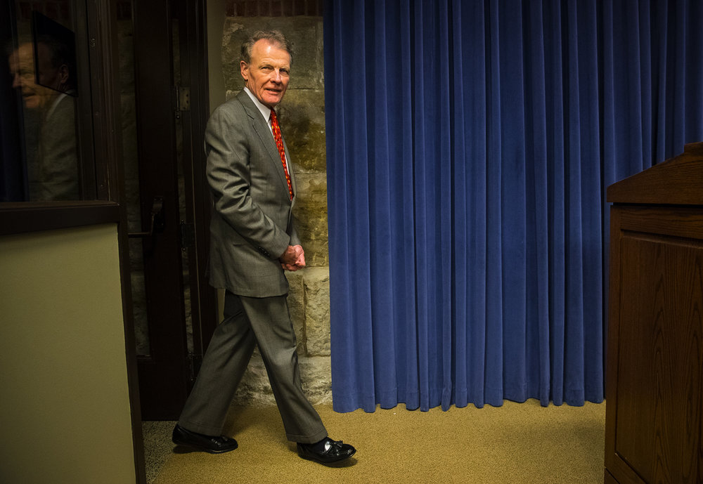 House Speaker Michael Madigan, center, D-Chicago, enters the blue room in the basement of the Capitol in Springfield, Ill., to answer questions following a meeting with the four legislative leaders Tuesday, June 27, 2017. Madigan said it was up to the Republican leaders to persuade Gov. Bruce Rauner to be reasonable as the deadline for a budget deal before the end of the fiscal year, June 30, arrives. [Ted Schurter/The State Journal-Register]