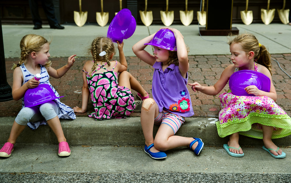 Alice Liberman, left, Milly Jackson, Caroline Bryans and Lily Swanson wait patiently for the end of the ceremonial groundbreaking and the beginning of the bubble blowing outside the site of the Kidzeum of Health and Science on Adams Street Thursday, June 29, 2017. Construction on the site begins next week. [Ted Schurter/The State Journal-Register]