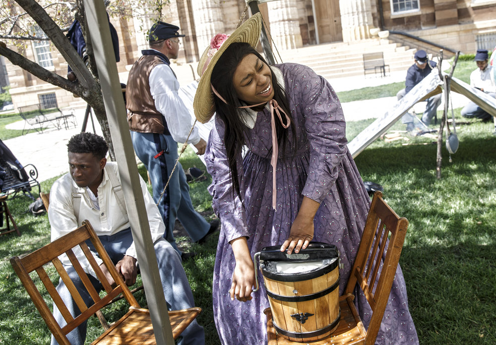 Kelsey Alexander takes her turn at turning at making homemade ice cream while serving with the Spirit of Lincoln Youth Leadership Academy portraying the 29th Regiment Infantry of the United States Colored Troops as a part of History Comes Alive at the Old State Capitol, Friday, June 30, 2017, in Springfield, Ill. The group can be found on Old State Capitol lawn on Wednesday through Saturdays in the afternoon. [Justin L. Fowler/The State Journal-Register]
