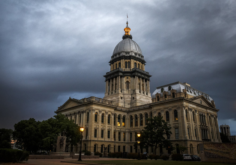 Storm clouds move over the Illinois State Capitol as the state prepares to begin a new fiscal year without a budget for the third year in a row, Friday, June 30, 2017, in Springfield, Ill. [Justin L. Fowler/The State Journal-Register]