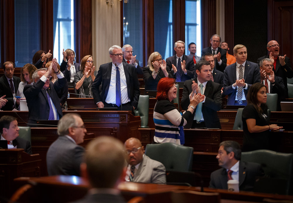 """I want this done today,"" says Illinois House Minority Leader Jim Durkin, R-Western Springs, as the Republican side of the aisle erupts in applause on the House floor after Illinois Speaker of the House Michael Madigan, D-Chicago, says House will be in session Sunday, but no bills are expected to be called, during the overtime session at the Illinois State Capitol, Saturday, July 1, 2017, in Springfield, Ill. [Justin L. Fowler/The State Journal-Register]"