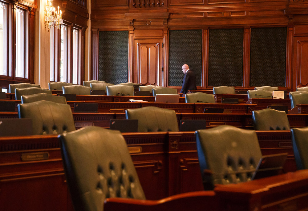 Illinois State Rep. Greg Harris, D-Chicago, walks through the empty floor of the Illinois House as they prepare to vote on a tax hike bill during the overtime session at the Illinois State Capitol, Sunday, July 2, 2017, in Springfield, Ill. [Justin L. Fowler/The State Journal-Register]