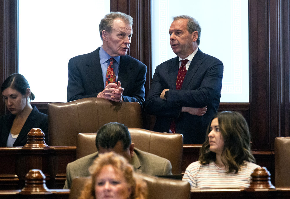 House Speaker Michael Madigan, D-Chicago, left, and Senate President John Cullerton, D-Chicago, talk on the Senate floor Tuesday, July 4, 2017 at the Capitol in Springfield, Ill. Madigan was in the chamber to watch the Senate pass a package of budget bills. [Rich Saal/The State Journal-Register]