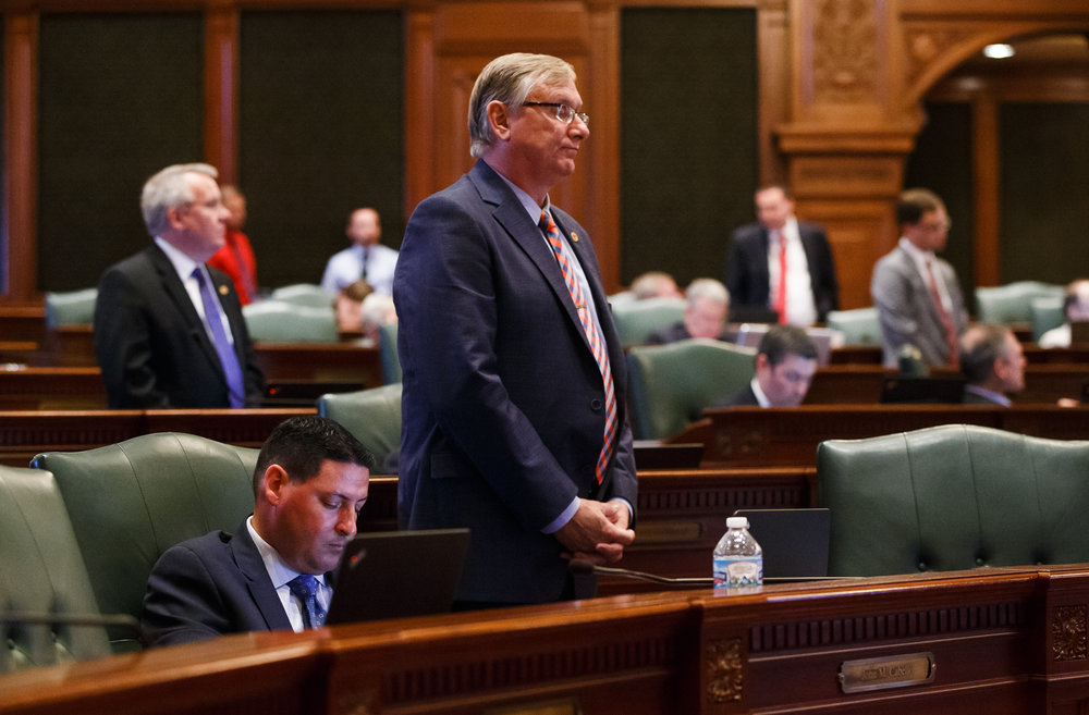 Illinois State Rep. Brian Stewart, R-Freeport, listens as Illinois Speaker of the House Michael Madigan, D-Chicago, gives a speech after the Illinois House voted to override Gov. Rauner's veto and pass a budget for the first time in two years during the overtime session at the Illinois State Capitol, Thursday, July 6, 2017, in Springfield, Ill. [Justin L. Fowler/The State Journal-Register]