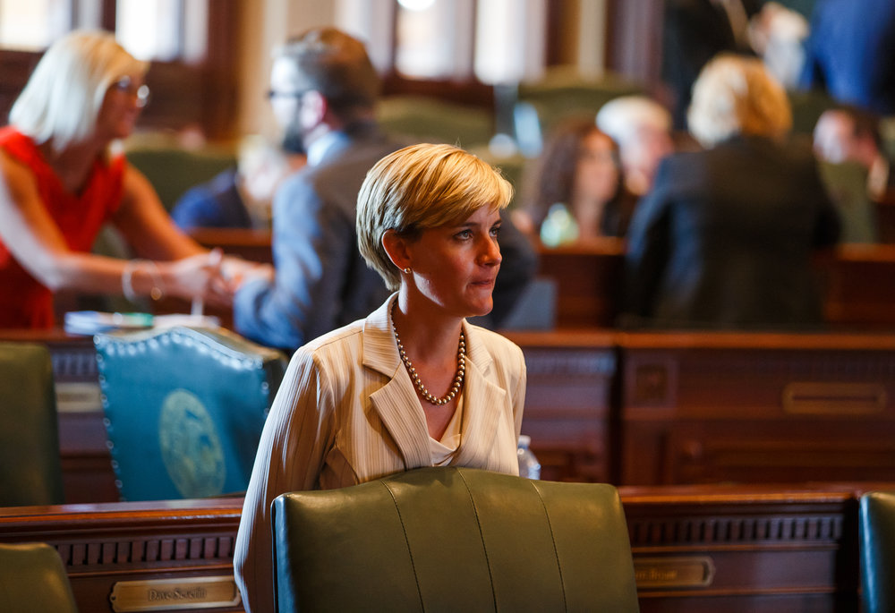 Illinois State Rep. Sara Wojcicki Jimenez, R-Leland Grove, stands behind her chair on the floor of the Illinois House after they voted to override Gov. Rauner's veto and pass a budget for a first time in two years during the overtime session at the Illinois State Capitol, Thursday, July 6, 2017, in Springfield, Ill. [Justin L. Fowler/The State Journal-Register]