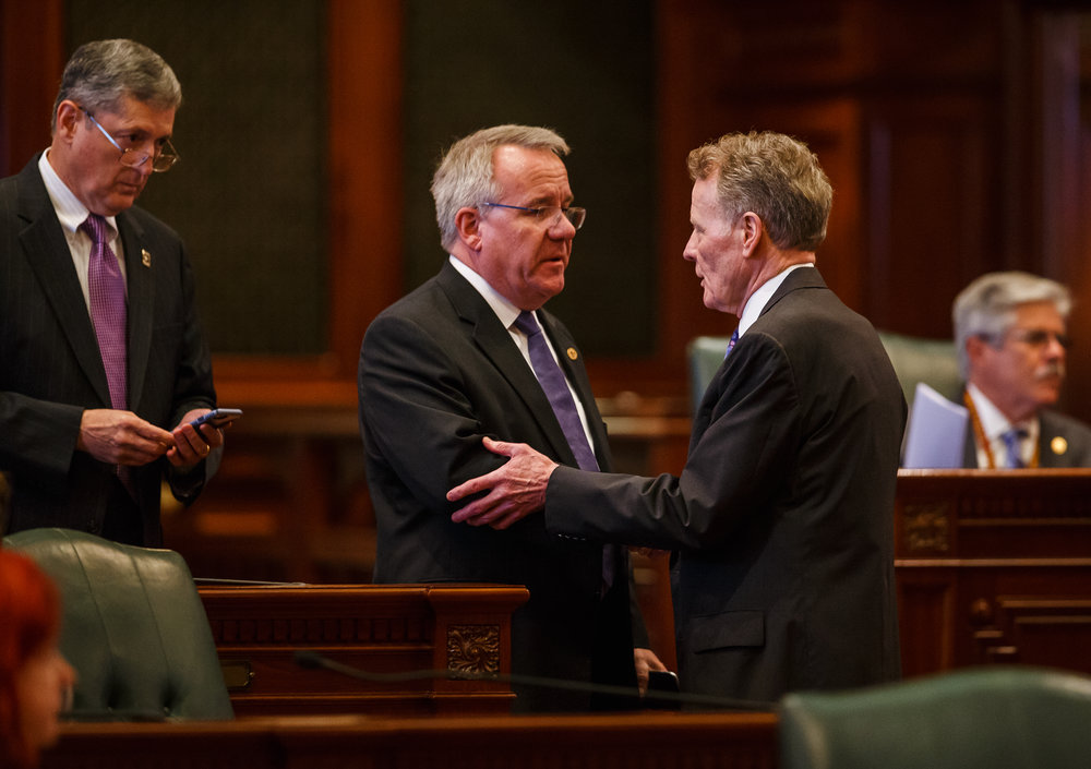 Illinois State Rep. Steve Andersson, R-Geneva, center, shakes hands with Illinois Speaker of the House Michael Madigan, D-Chicago, right, along with Illinois State Rep. David Harris, R-Arlington Heights, left, after the Illinois House voted to override Gov. Rauner's veto and pass a budget for the first time in two years during the overtime session at the Illinois State Capitol, Thursday, July 6, 2017, in Springfield, Ill. Andersson and Harris are two of the ten Republicans that voted in favor of the override. [Justin L. Fowler/The State Journal-Register]�