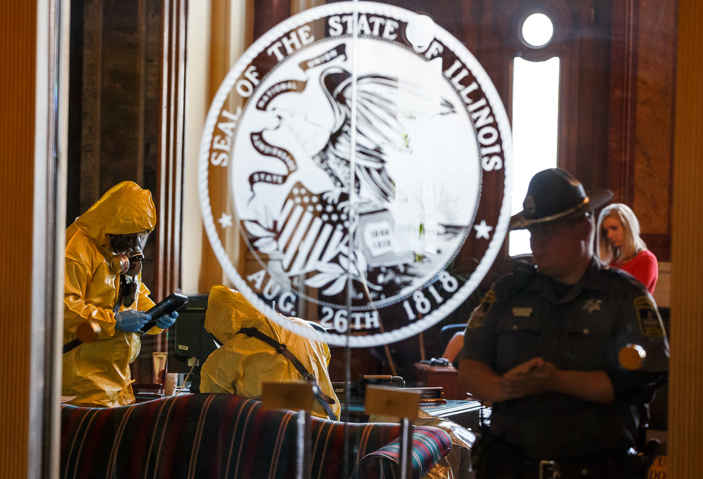 The Springfield Fire Dept. and the Hazardous Materials Unit test the scene of the Governor's office after the building went on lockdown after a woman threw a powdery substance in the office during the overtime session at the Illinois State Capitol, Thursday, July 6, 2017, in Springfield, Ill. [Justin L. Fowler/The State Journal-Register]