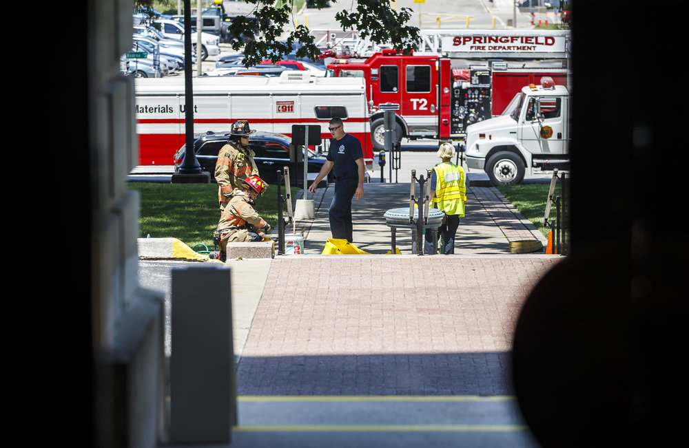 The Springfield Fire Dept. and the Hazardous Materials Unit respond to the north entrance of the Illinois State Capitol as the building goes on lockdown after a woman threw a powdery substance in the Governor's office during the overtime session at the Illinois State Capitol, Thursday, July 6, 2017, in Springfield, Ill. [Justin L. Fowler/The State Journal-Register]
