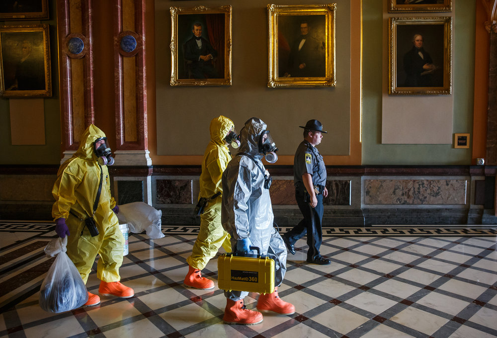 The Springfield Fire Dept. and the Hazardous Materials Unit walk down the Hall of Governors after working a scene in the Governor's office after the building went on lockdown after a woman threw a powdery substance in the Governor's office during the overtime session at the Illinois State Capitol, Thursday, July 6, 2017, in Springfield, Ill. [Justin L. Fowler/The State Journal-Register]