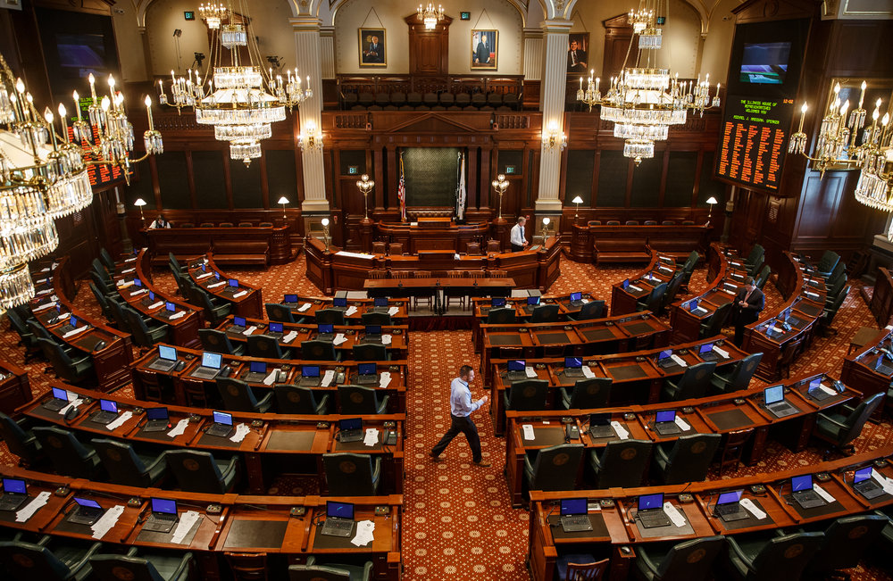 Staff test each desk on the floor of the Illinois House as they prepare for a potential vote on overriding Illinois Governor Bruce Rauner's veto of the budget bills during the overtime session at the Illinois State Capitol, Thursday, July 6, 2017, in Springfield, Ill. [Justin L. Fowler/The State Journal-Register]