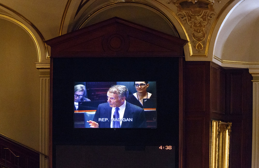 House Speaker Michael Madigan, D-Chicago, is seen on an overhead screen delivering remarks after the House voted to override Gov. Bruce Rauner's veto of a budget package in the House chamber at the Capitol Thursday, July 6, 2017. [Rich Saal/The State Journal-Register]
