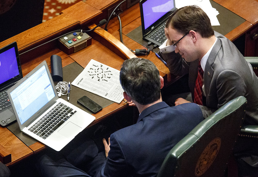 Rep. Will Guzzardi, D-Chicago, and Rep. David Olsen, R-Downers Grove, work on a puzzle on the House floor while the State Capitol is on lockdown during a hazardous materials incident Thursday, July 6, 2017. [Rich Saal/The State Journal-Register]