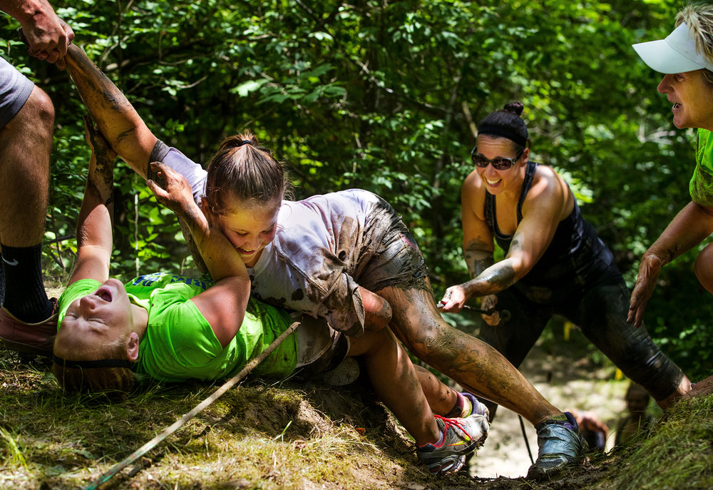Kylie Kruse collapses onto Kimberly Waldrup as she tries to pull her to the top of a steep hill with help from Adam Johns, left, and her mom Ceressa during the Big Dawg Dare in Litchfield Saturday, July 15, 2017. Kruse's mom, Leanne, is behind her. [Ted Schurter/The State Journal-Register]